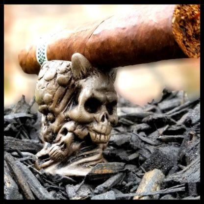 Skull Cigar Stand with cigar