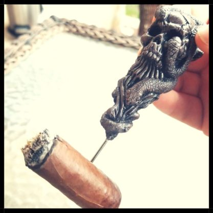 Skull Cigar Nubber With Cigar